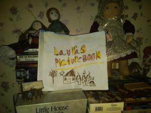 "Just a few pieces of my Laura-related swag.  The book was made by a little girl I met at Almanzo's birthplace, The Wilder Farm in Burke, New York.  She illustrated several scenes from the first 3 books in the series.  Meanwhile, many people who attend my first-person educational history programs, which feature a ""visit"" with an adult Laura circa 1895, ask questions that are clearly related to television episodes and have nothing to do with the books..."
